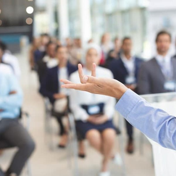 Professional speaker presenting a keynote to a corporate office